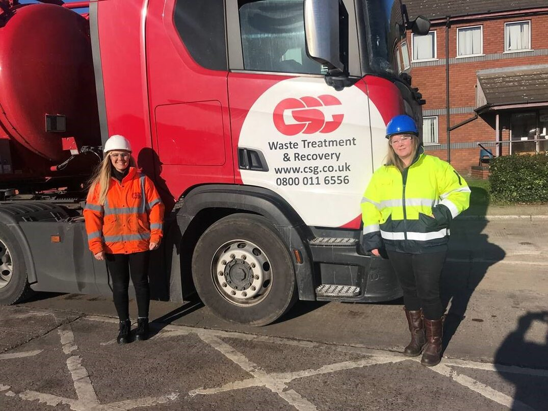 Sam (left) and Cheryl (right) posing in front of a CSG truck.